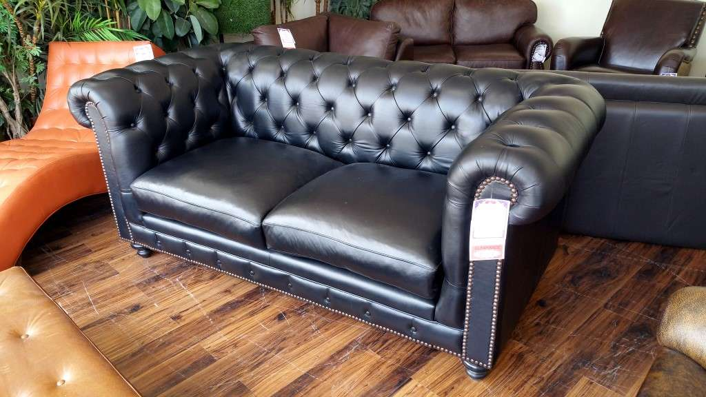 the kensington 2 seat sofa is in luscious black leather